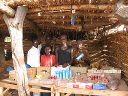 Tonkassare Villagers selling batteries, flashlights, matches, soap, and other items